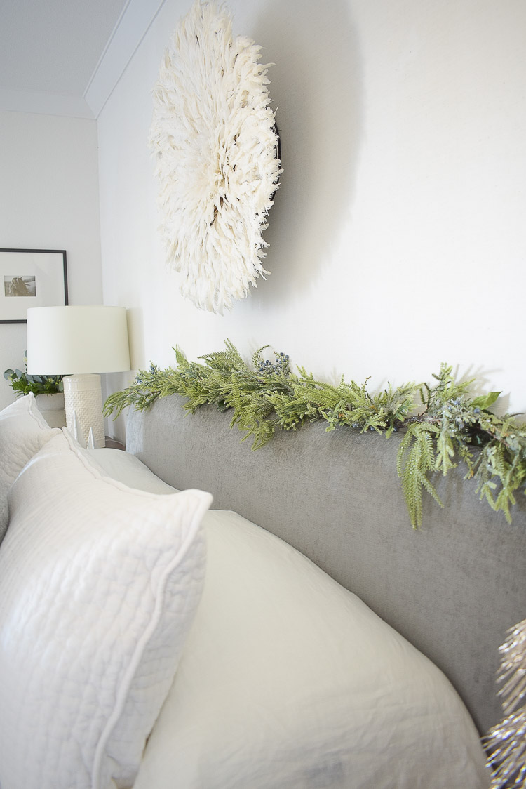 Holiday Bedroom Tour - christmas garland on headboard