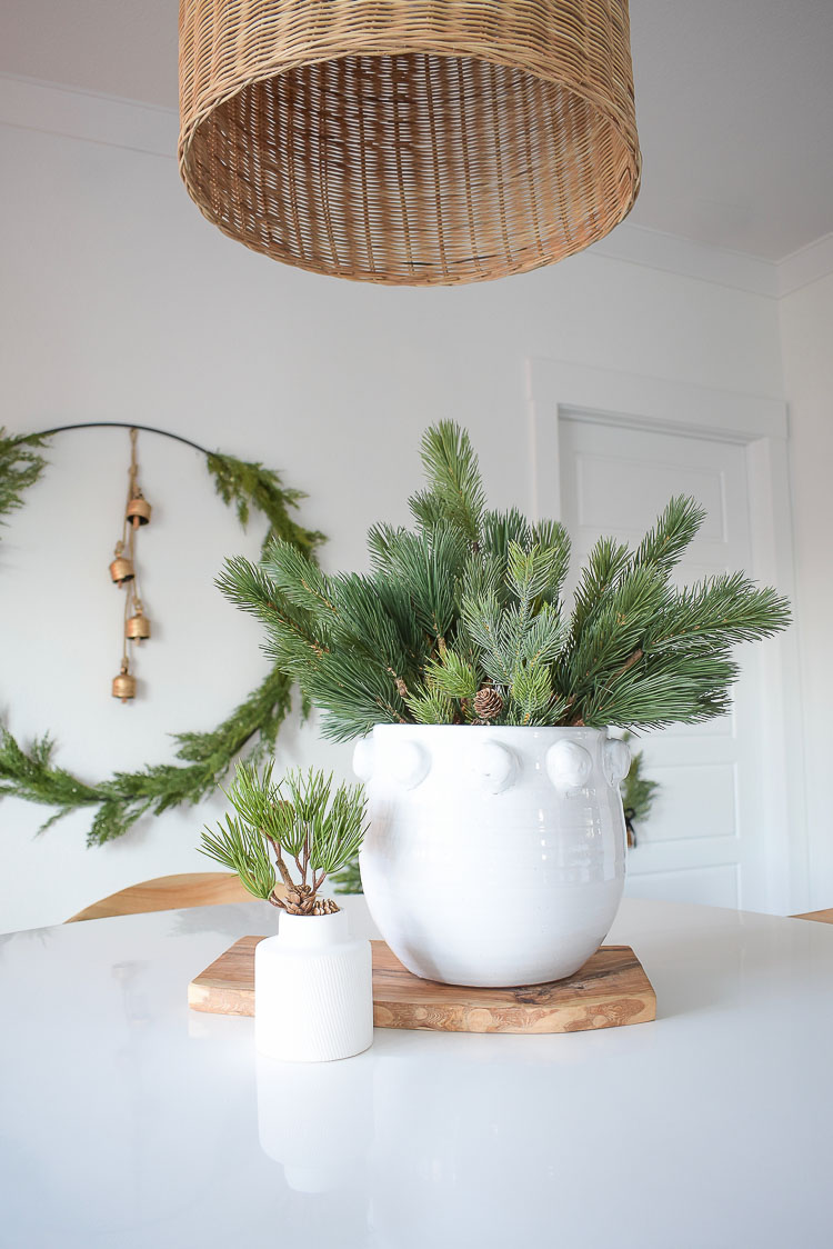 Christmas Dining Room Tour - White dot planter with pine branches centerpiece