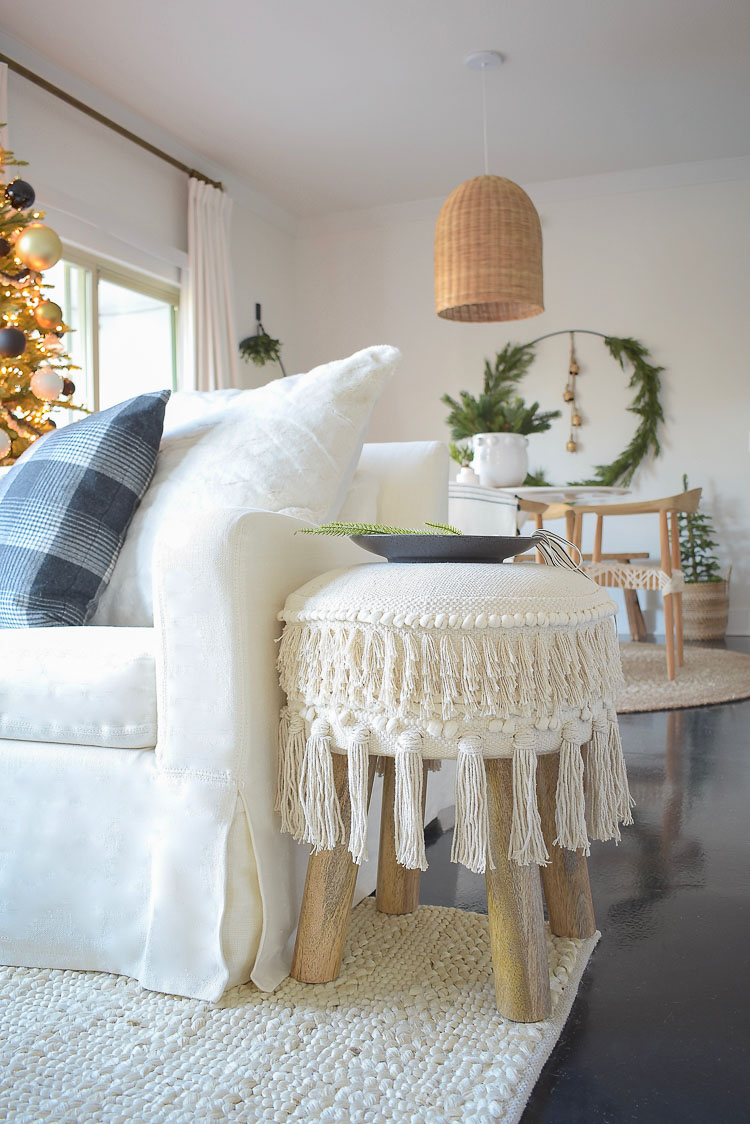 Black, white & gold modern Christmas living room tour - fringe hassle stool / ottoman