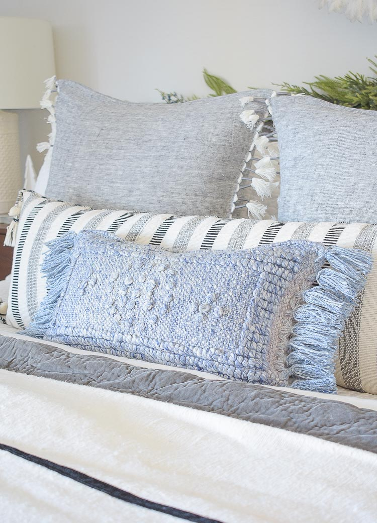 Holiday Bedroom Tour - blue textured indoor outdoor pillow with fringe