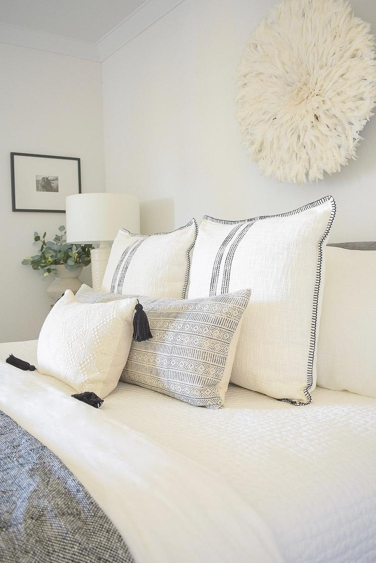Spring bedroom tour - black and white boho pillows