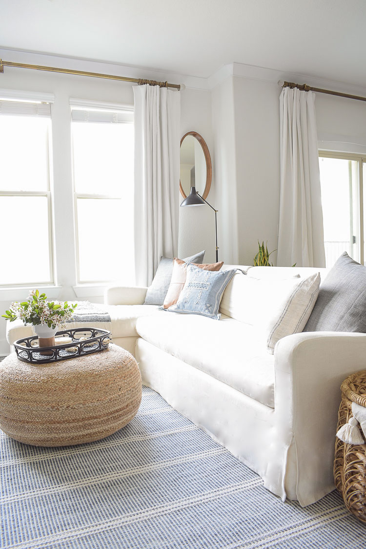 blue and white patterned annie selke rug in spring living room tour