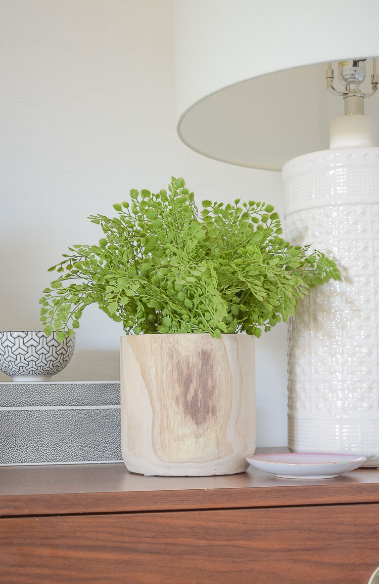 how to style your nightstand with faux greenery - faux fern in wooden pot