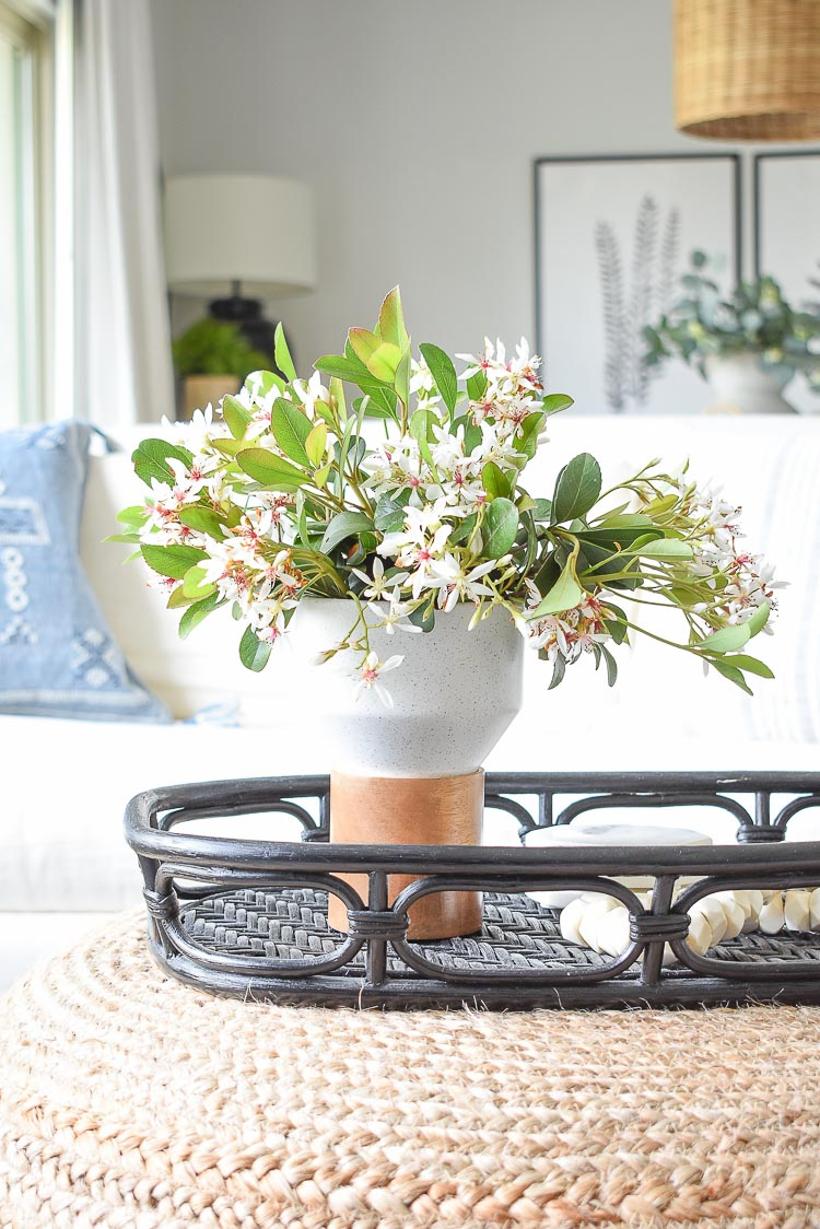 Spring flower arrangement with Indian Hawthorne on coffee table in spring tour