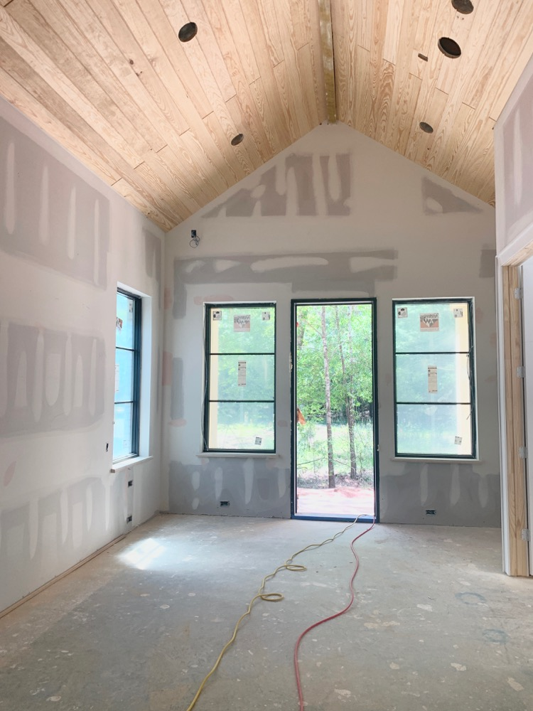 Transitional Modern Master Bedroom Under Construction with V-Groove Ceiling and horizontal grid modern windows by Andersen