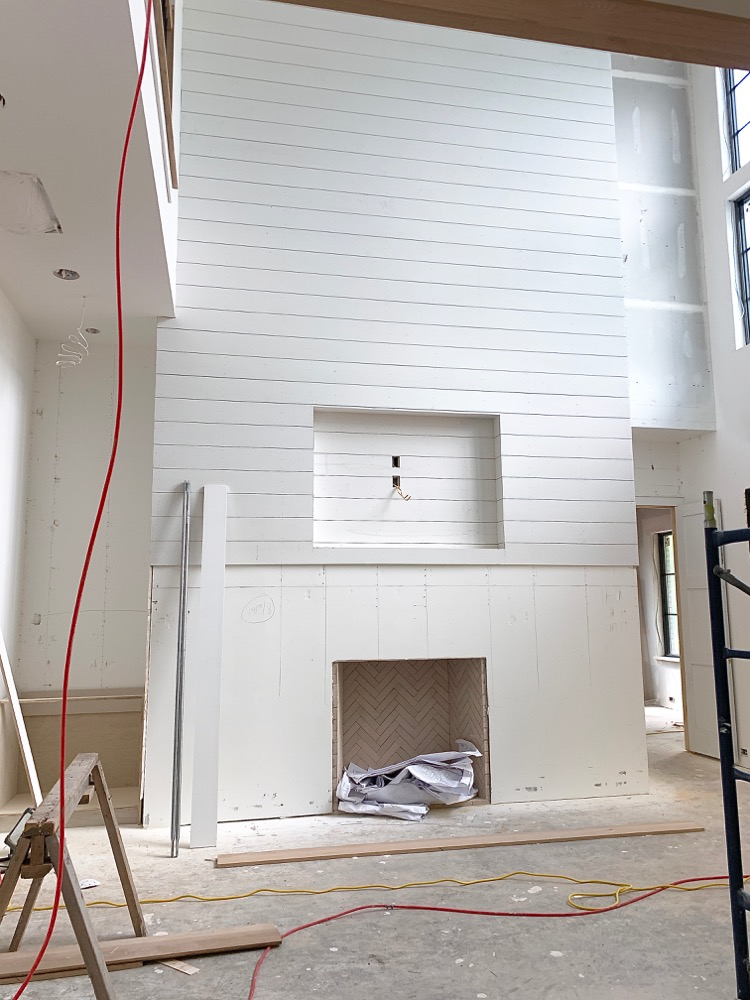 White shiplap fireplace - modern farmhouse under construction