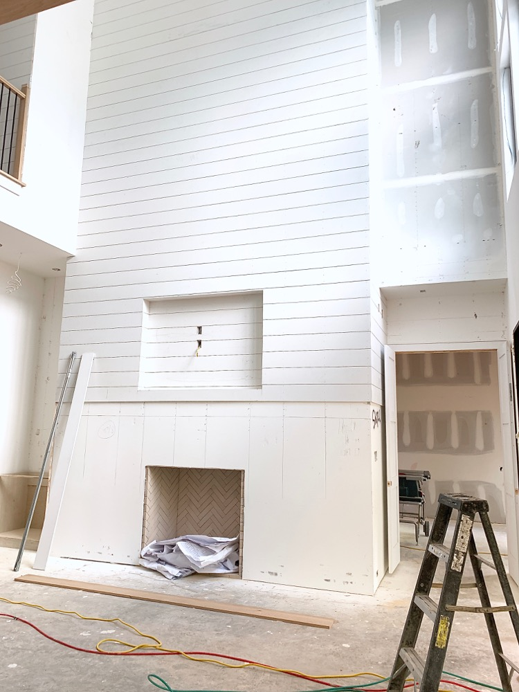 White Shiplap hallway - entryway in transitional modern home under construction