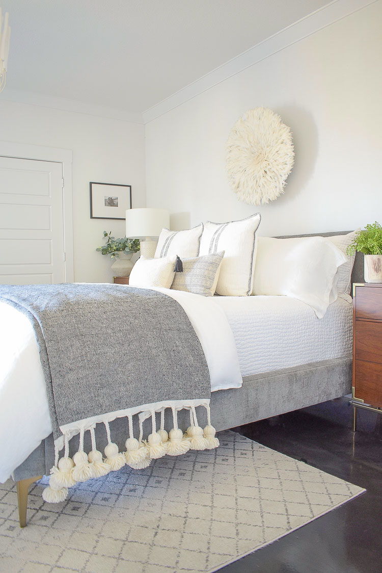 black and white sprig bedroom tour - juju hat and large tassel throw
