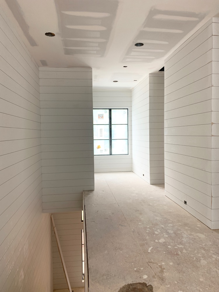 White shiplap in hallway on both sides