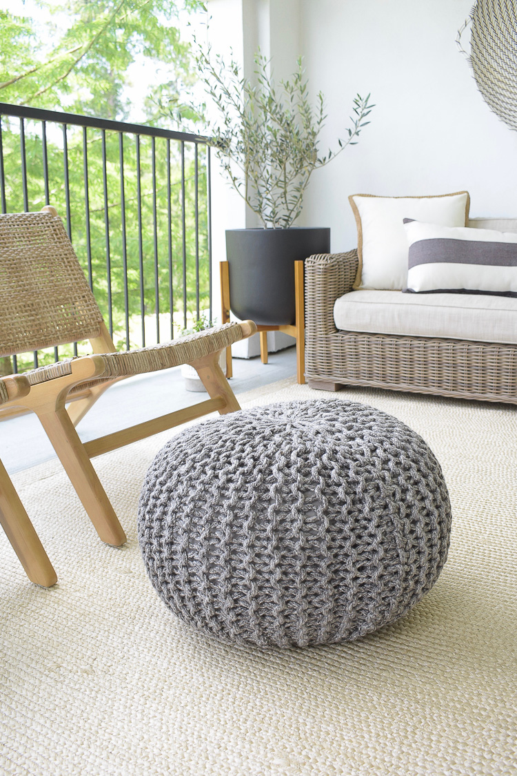Tips for Outdoor patio refresh - gray outdoor pouf