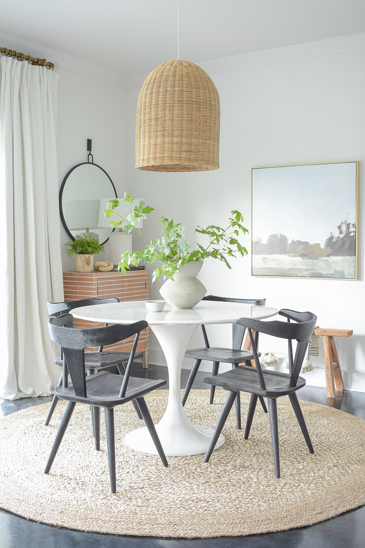 5 tips for summer decorating + a dining room summer home tour - boho chic dining space with black dining chairs, white tulip table, jute rug