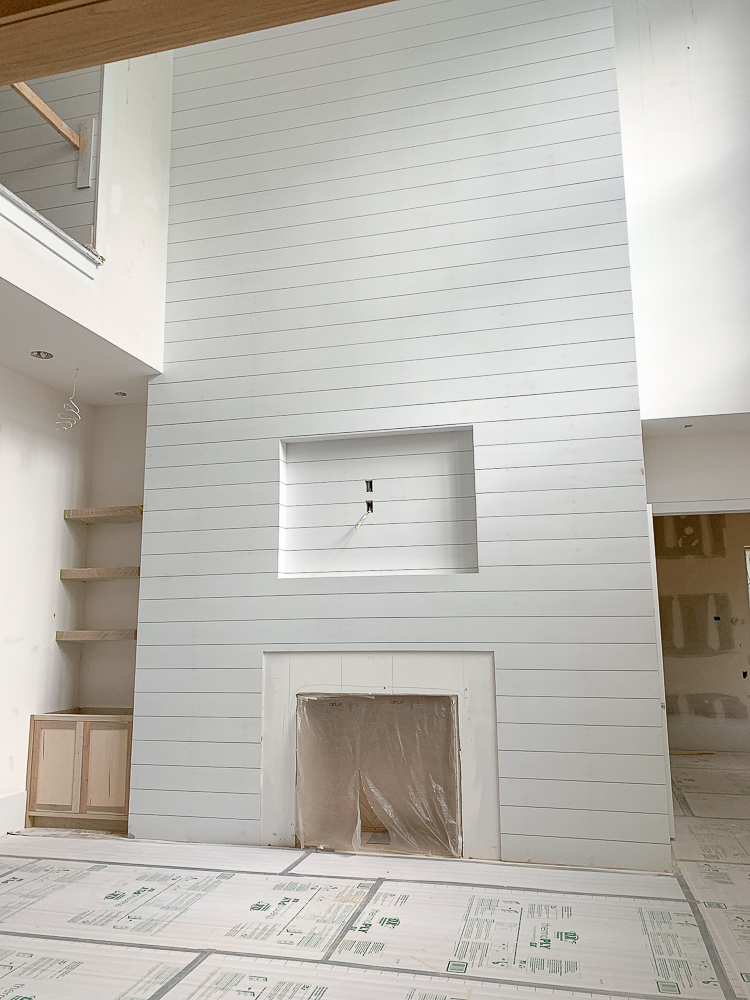 white shiplap fireplace wall