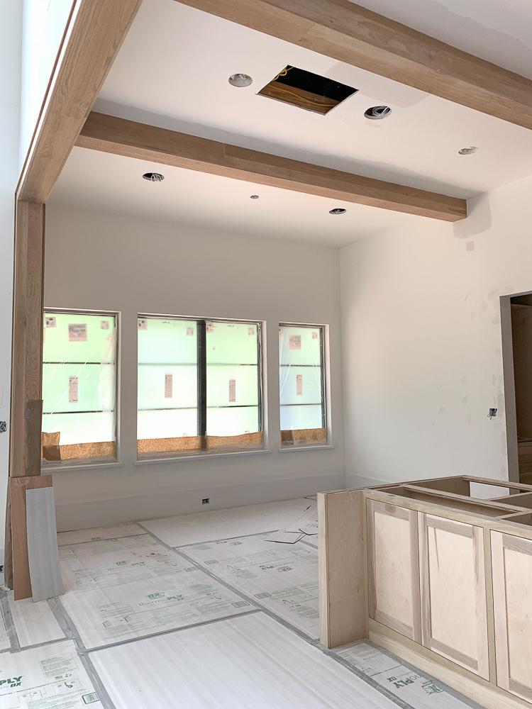 dining room off kitchen with white oak box beams
