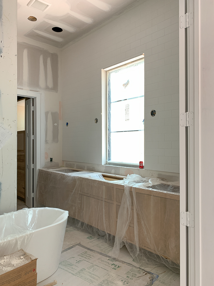 master bath white oak vanity modern farmhouse under construction