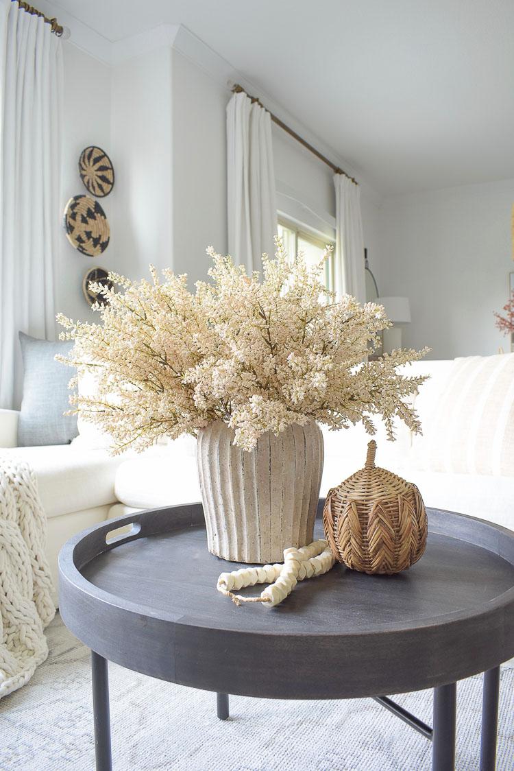 Fall coffee table decor, rattan pumpkin, bone beads, fall arrangement