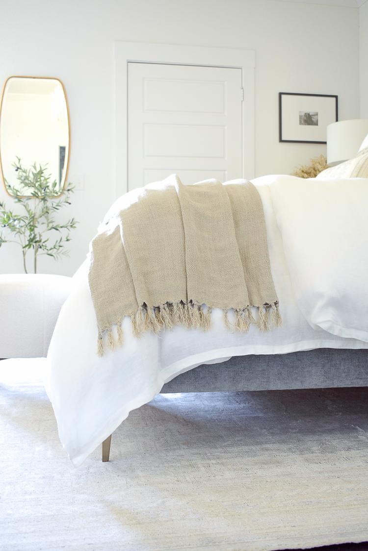 Montauk pom pom at home linen throw blanket