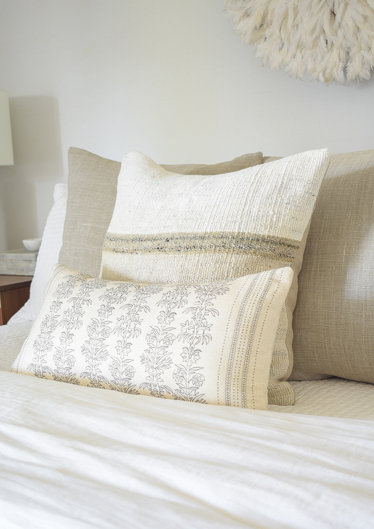 textured two-tone pillow with floral lumbar in front