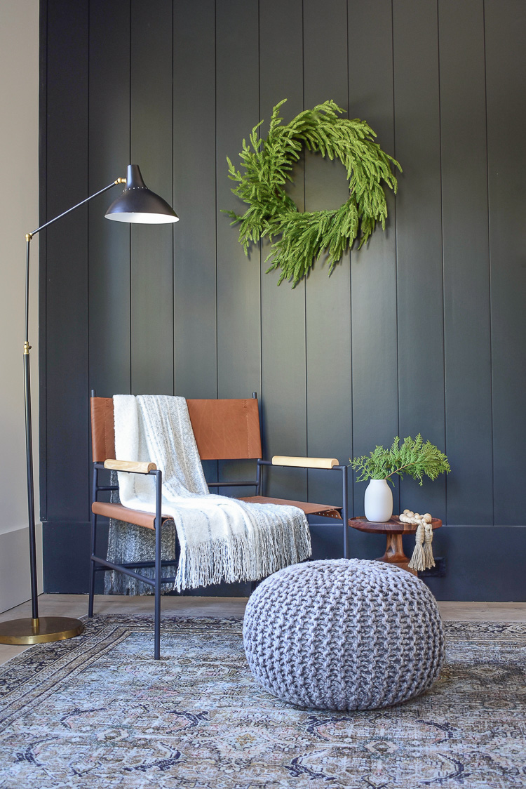 Modern leather sling chair with metal legs,black shiplap wall