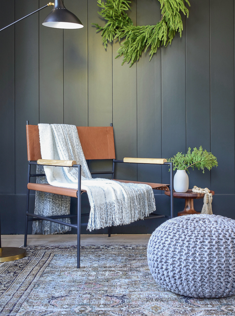 modern leather sling chair, black vertical shiplap wall, olive charcoal rug from Joss & Main Winter Edit