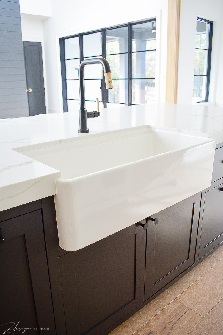 "Blanco 36"" farmhouse sink, black kitchen cabinets in island"