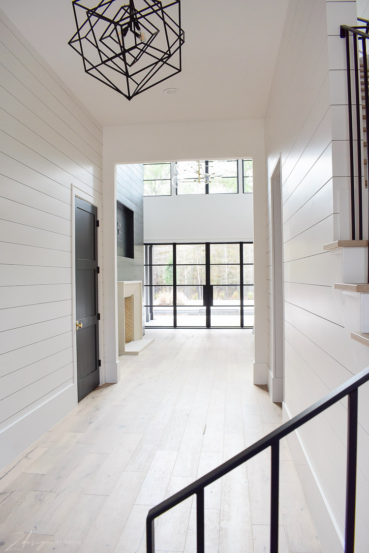 Large entry hall with shiplap and white oak floors