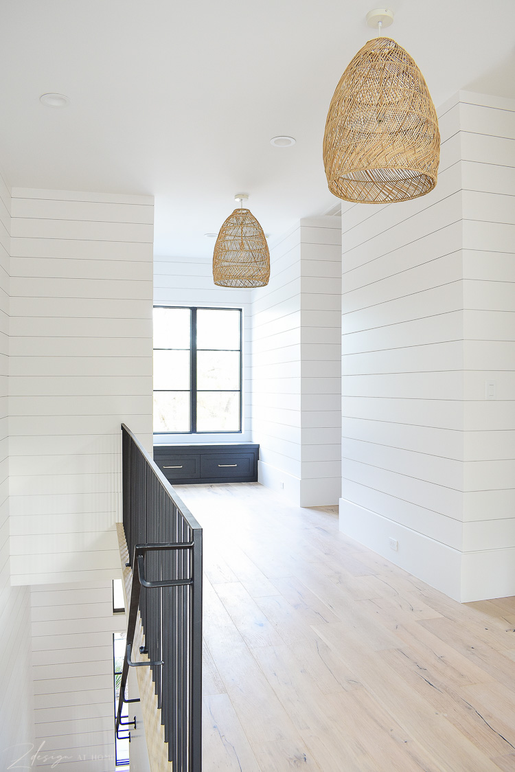 Hallway with basket pendants and window seat