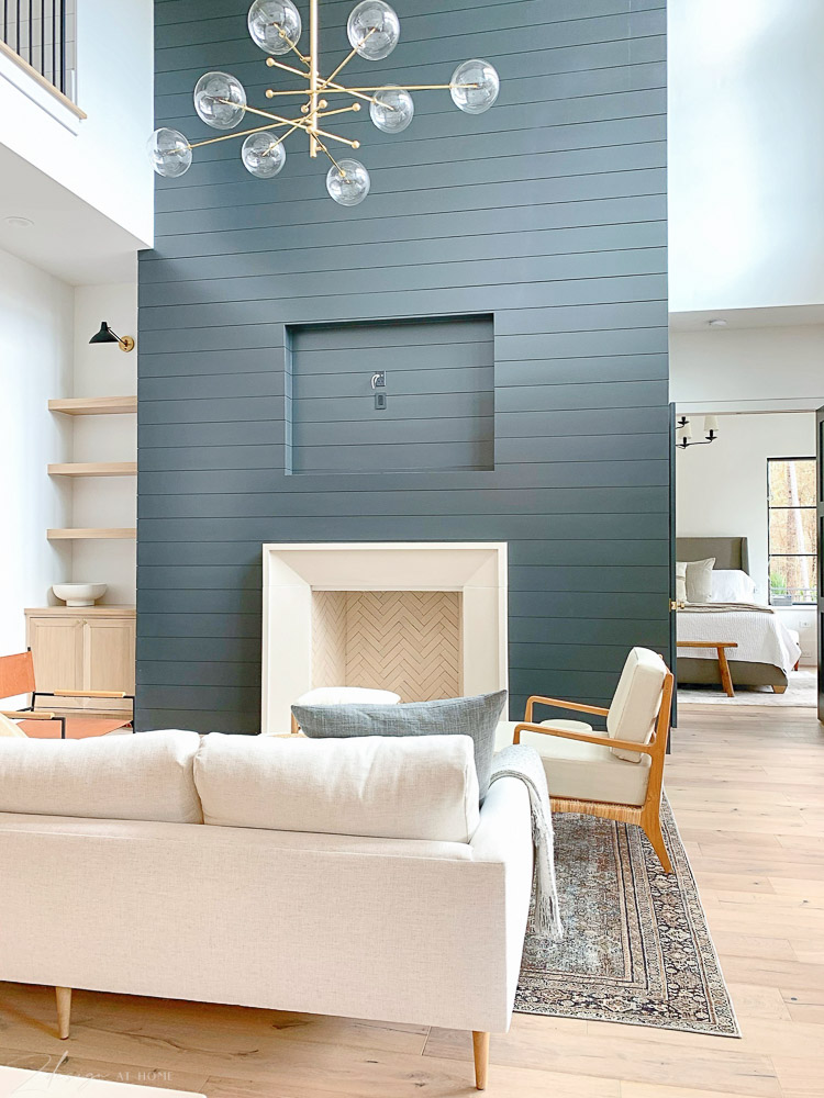 living room with black shiplap and capstone firempace, transitional modern style