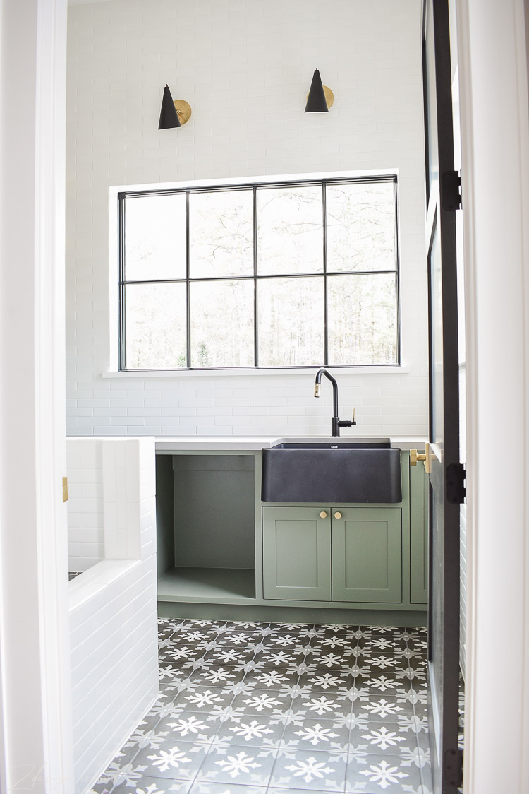 Beautiful laundry room, sink at window, black and white patterned floors, dog wash