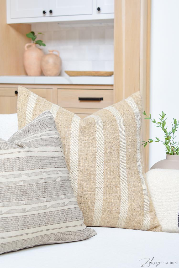 modern farmhouse pillows styled on sofa