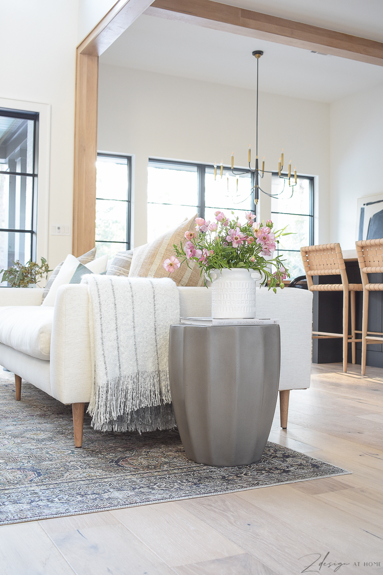 gray concrete side table white flowers vase jug for spring updates