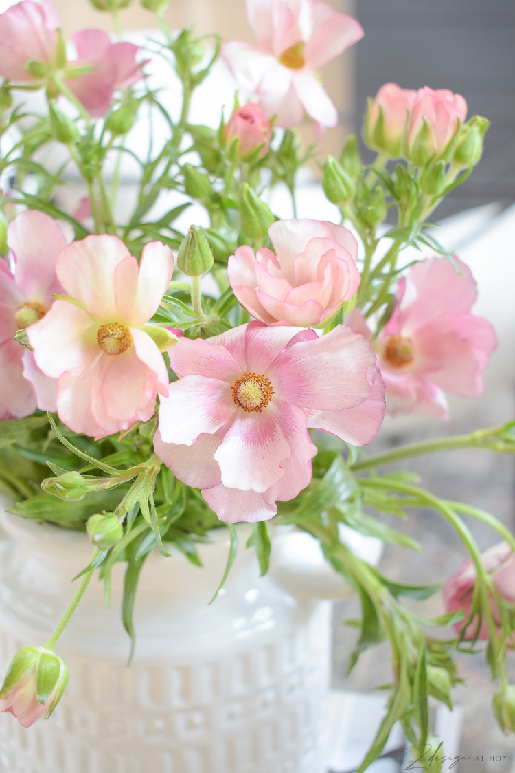 pink spring blooms in white jug vessel vase