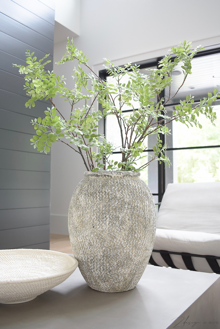 large gray textured table vase on modern concrete coffee table