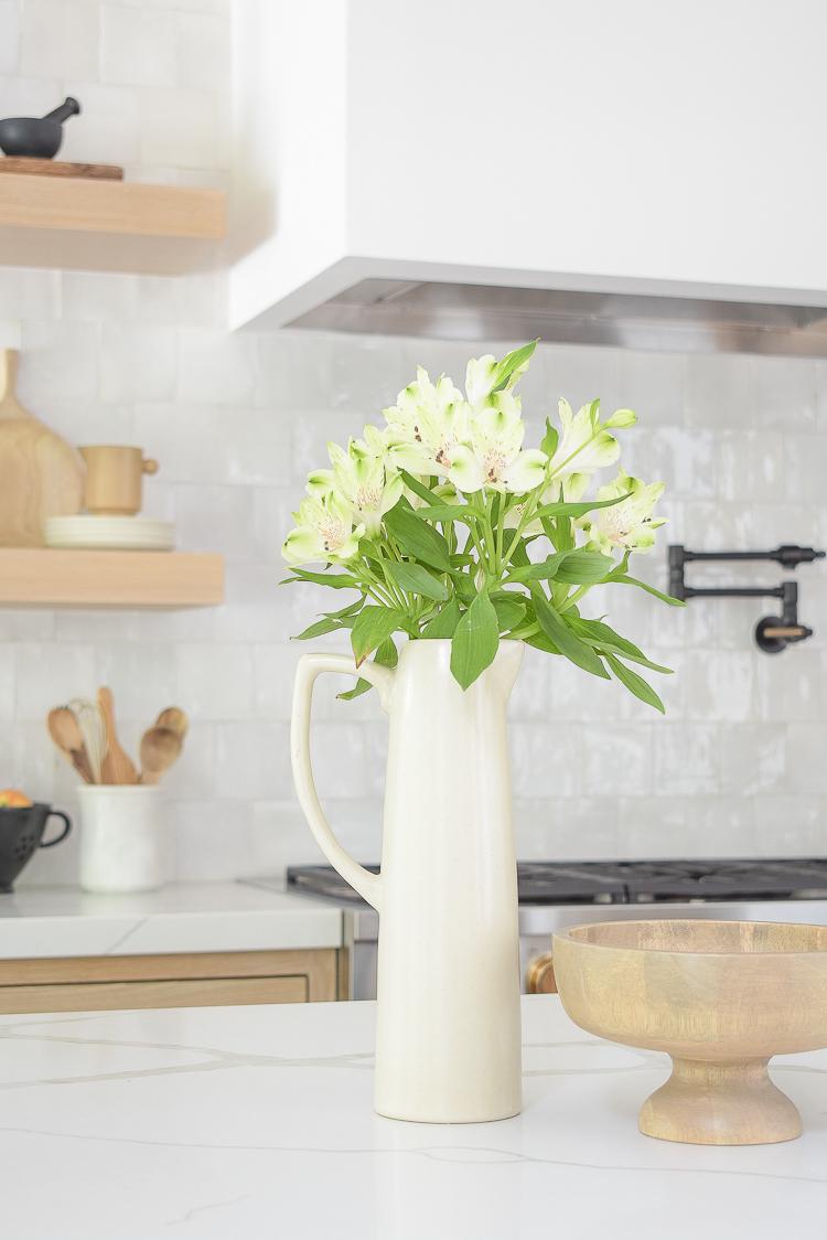 modern pitcher vase in front of zellige tile in modern kitchen