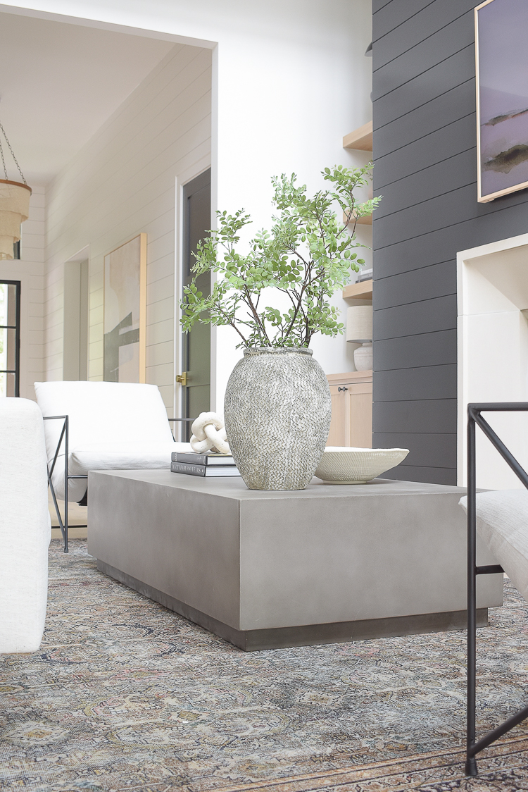 concrete coffee table in a living room reveal