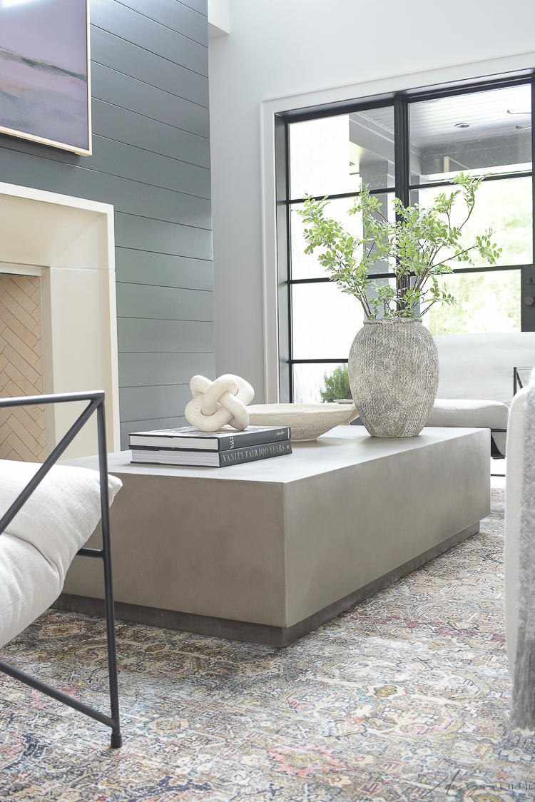 concrete coffee table with modern accessories