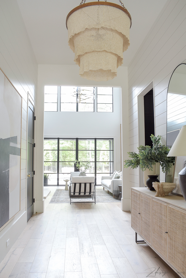 long entry hall with shiplap that goes into living room