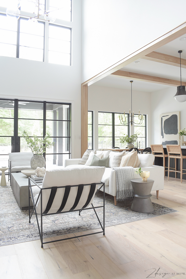 open airy living room with steel doors and soaring windows