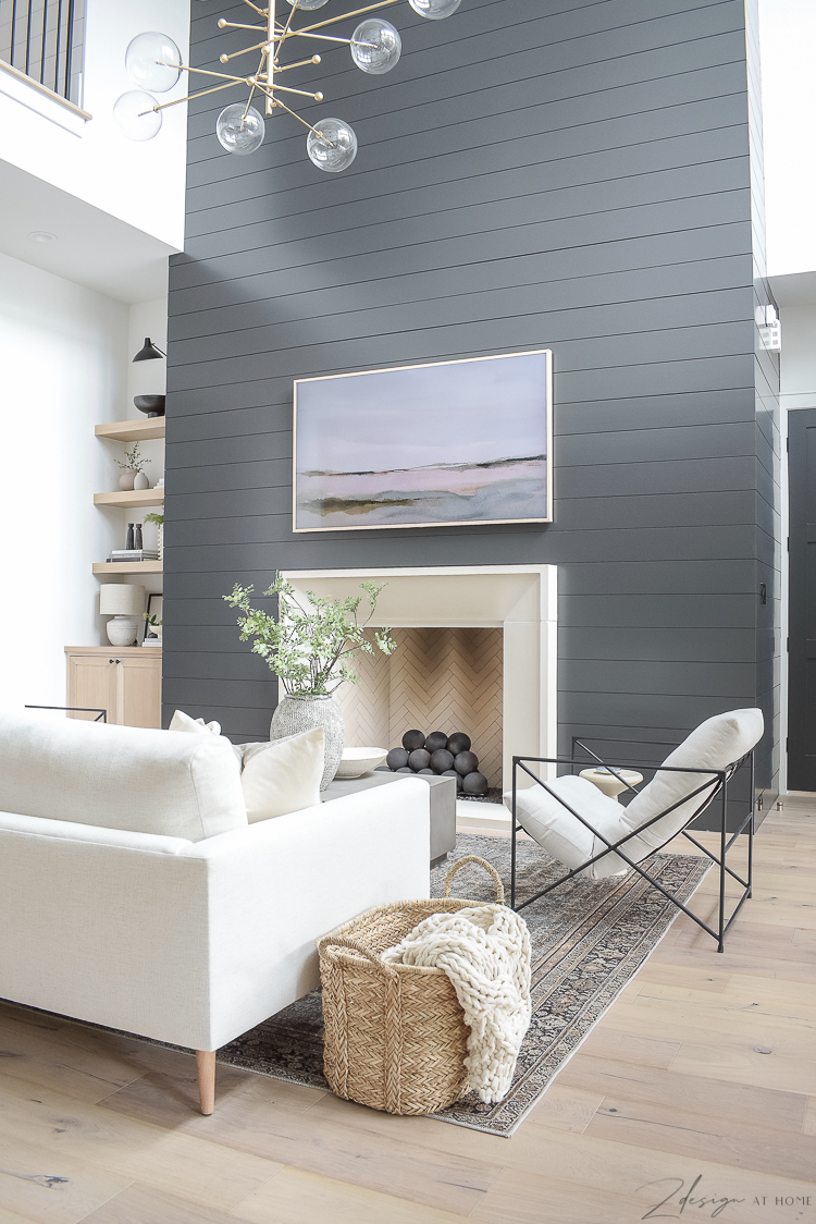 modern living room with black shiplap fireplace wall and isokern fireplace