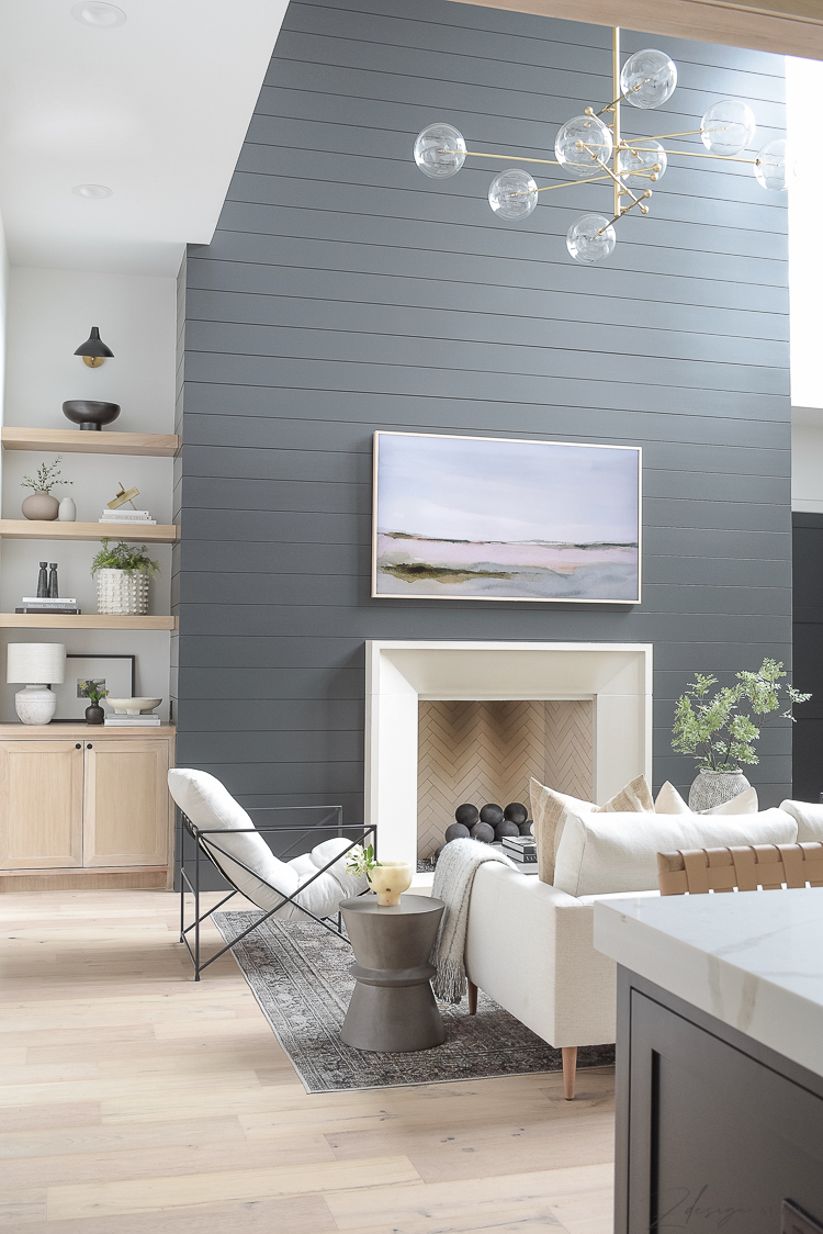 modern living room with black shiplap fireplace