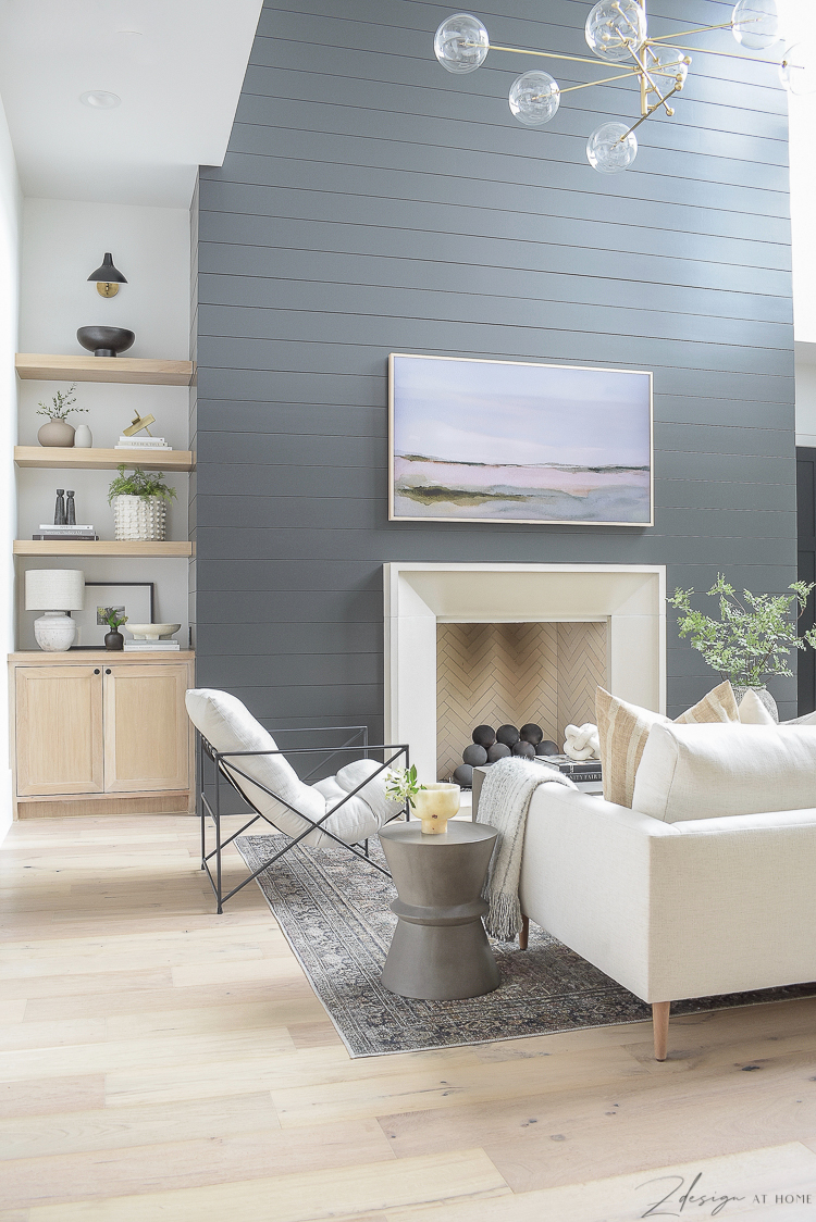 modern living room with black shiplap fireplace wall
