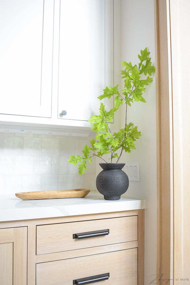 Oak stem in black CB2 pedestal vase