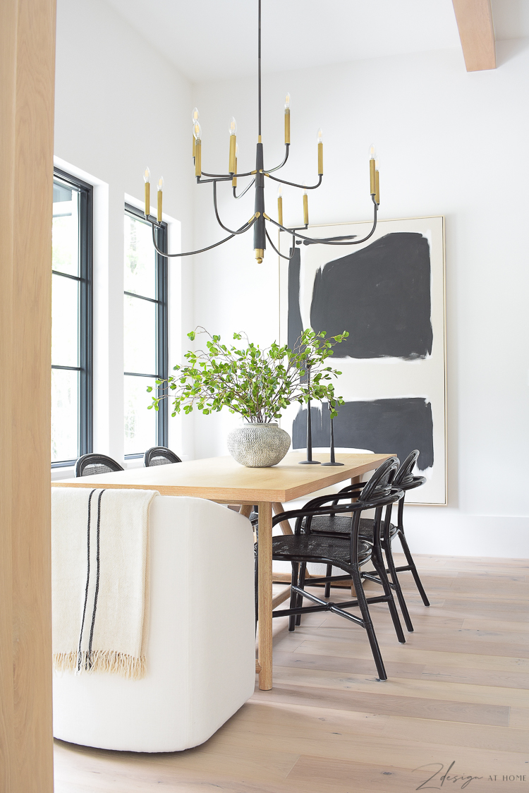 Transitional modern dining room with vase and stems, art and chandelier