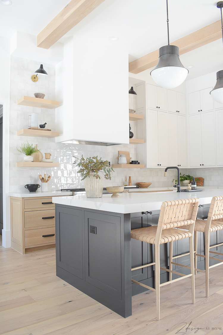 kitchen with 3 cabinet colors. ribbed vase. white oak cabinets, black island