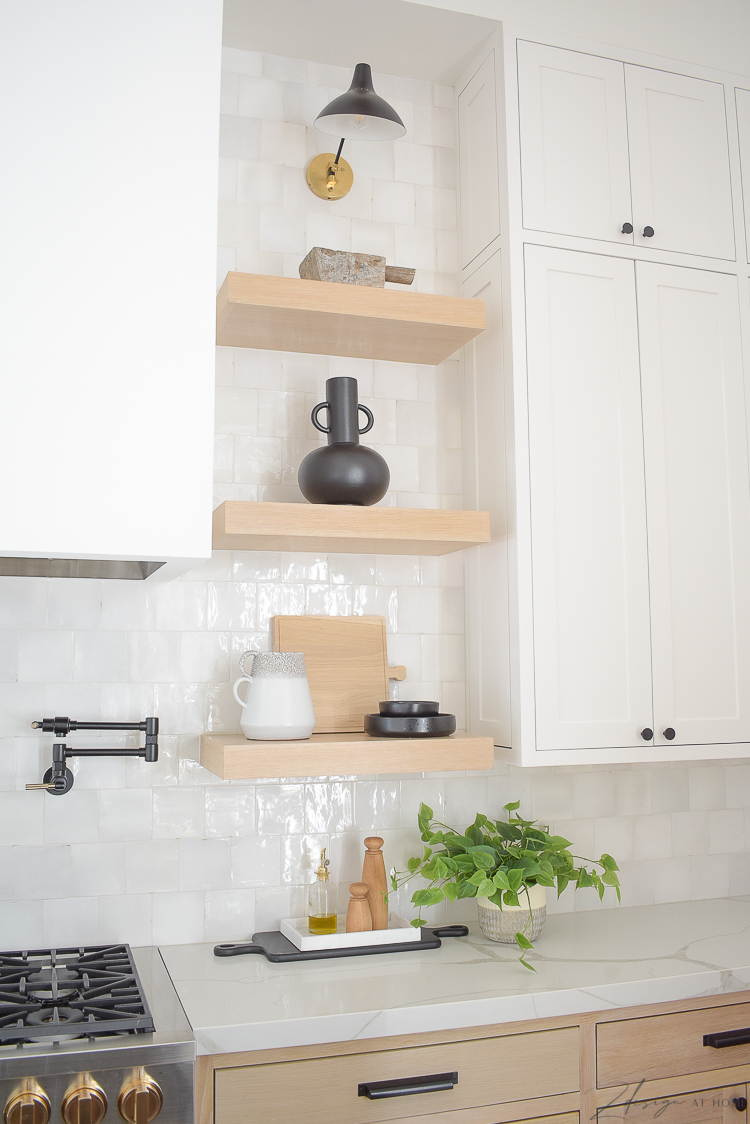 styled kitchen white oak shelves in front of zellige white tile