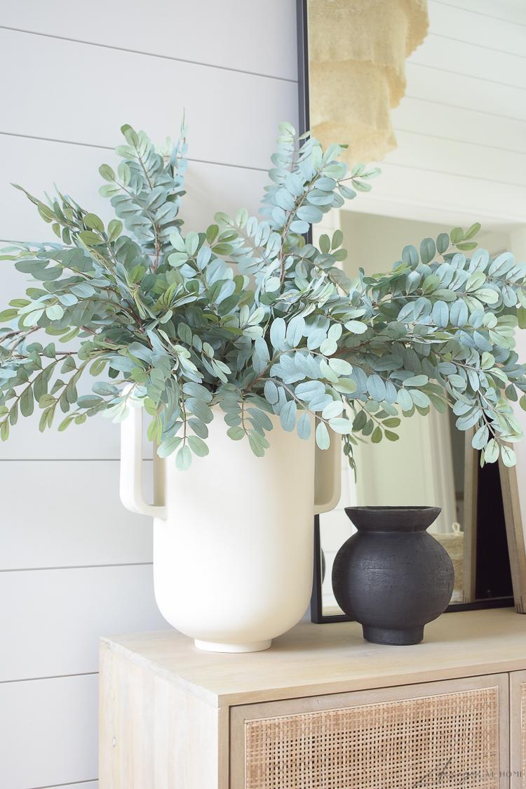 large white pedestal vase in foyer