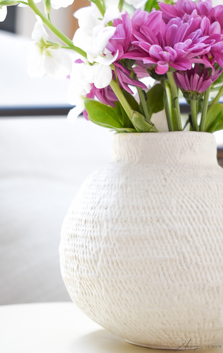 small white bud vase with fresh spring flowers