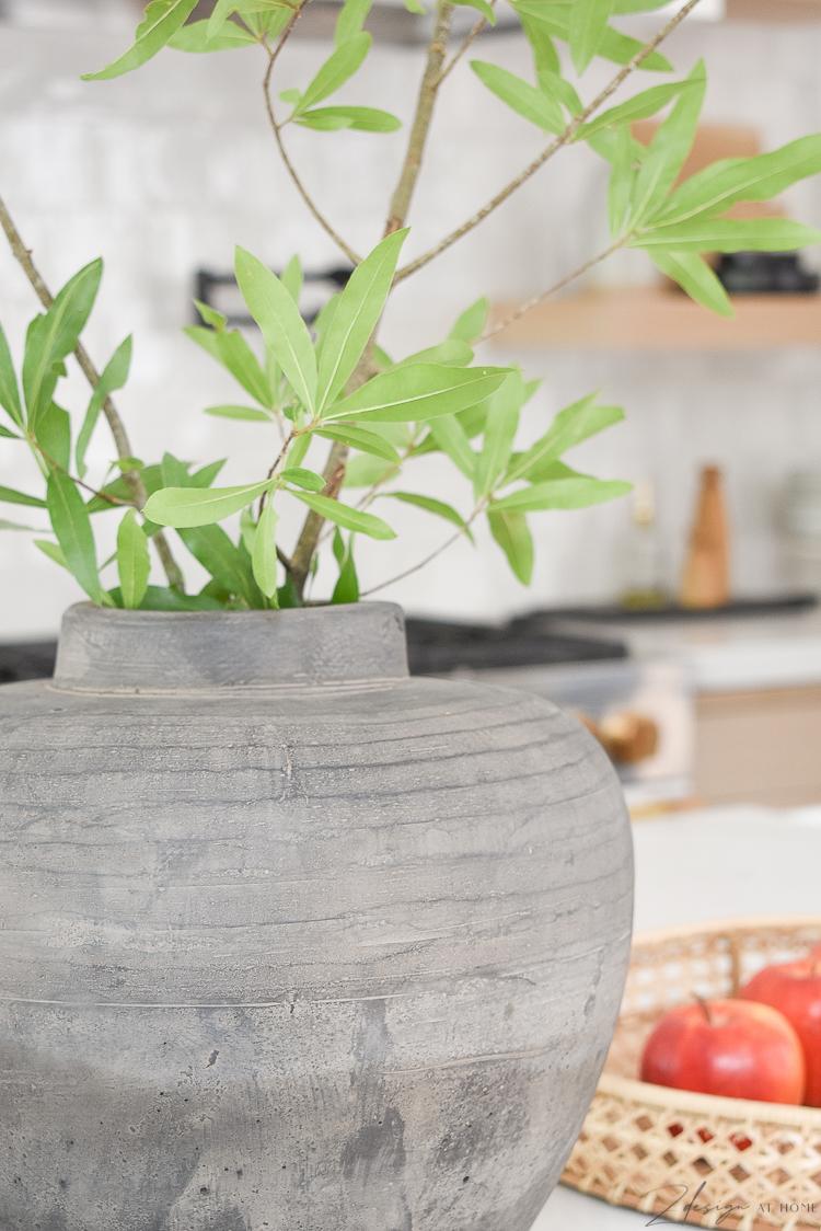 vintage inspired natural made vase on white quartz countertops