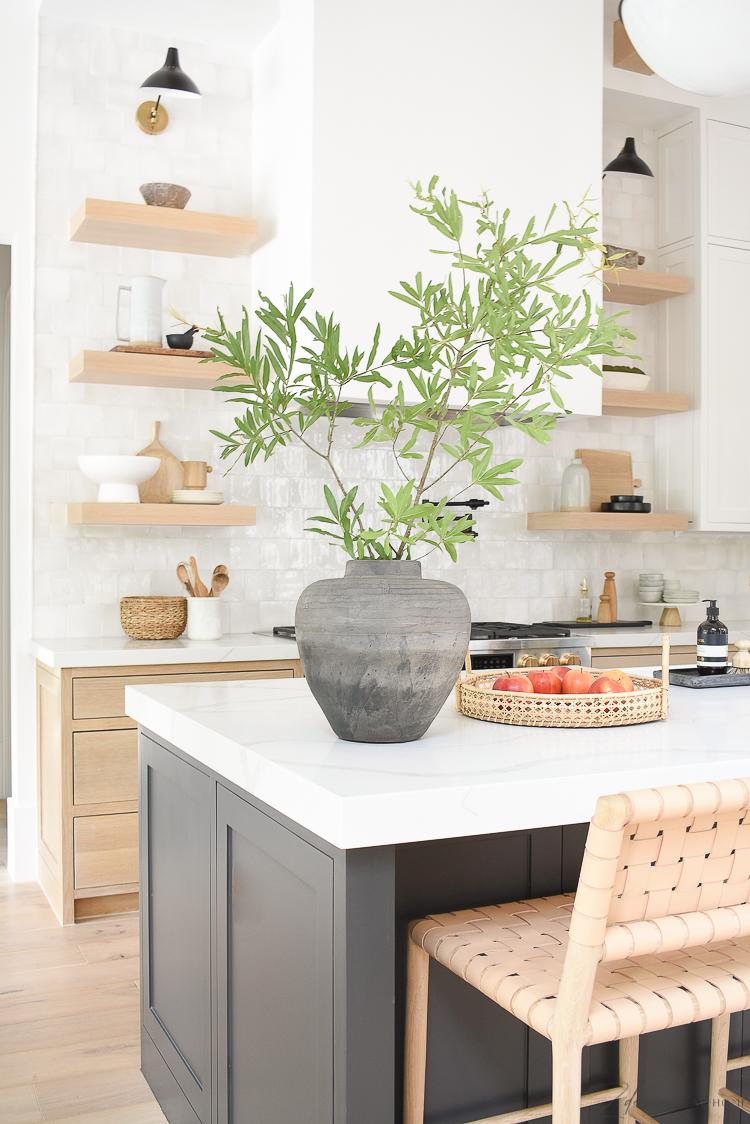 vintage inspired vase on modern kitchen counter top, white zellige tile