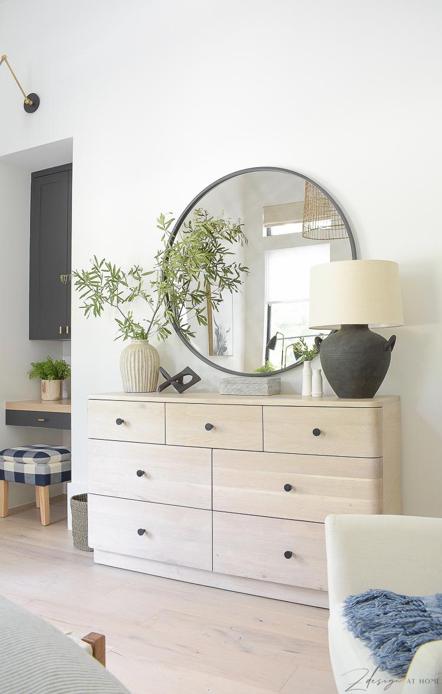 teenage boys room dresser, round black mirror styled with decor