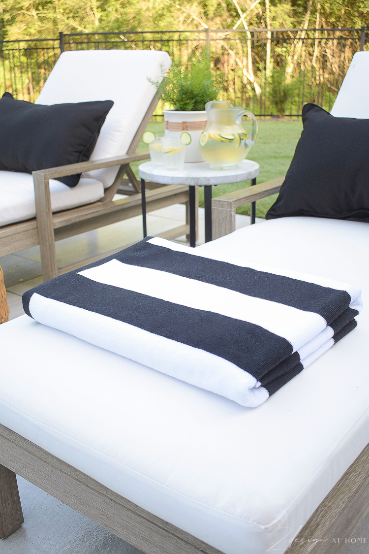 Black and white beach pool towels styled on patio loungers - Walmart Home